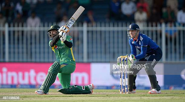Mohammad Hafeez of Pakistan hits out for six runs during the 3rd One Day International match between Pakistan and England at Sharjah Cricket Stadium...