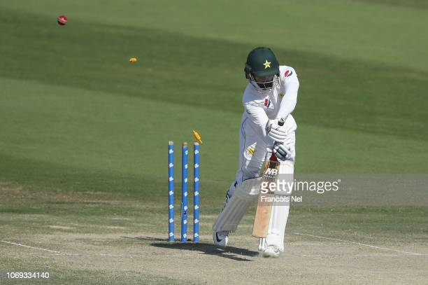 Mohammad Hafeez of Pakistan is bowled by Tim Southee of New Zealand during day five of The Third Test match between New Zealand and Pakistan at Zayed...