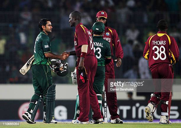 Mohammad Hafeez of Pakistan is congratulated by captain Darren Sammy of the West Indies during the first quarterfinal match of the ICC Cricket World...