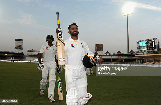 Mohammad Hafeez of Pakistan salutes the dressing room as he leaves the field at stumps on day three of the 3rd Test between Pakistan and England at...