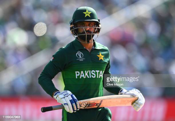 Mohammad Hafeez of Pakistan walks off having been dismissed off the bowling of Mujeeb Ur Rahman of Afghanistan during the Group Stage match of the...