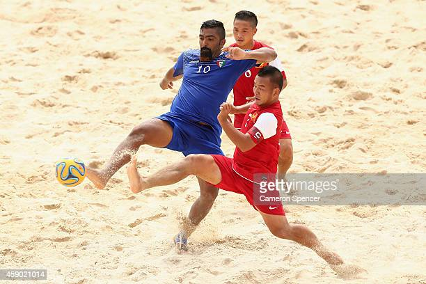 Mohammad Hussain of Kuwait and Kim Tuan Le of Vietnam contest the ball during the Beach Soccer match between Kuwait and Vietnam during the 2014 Asian...