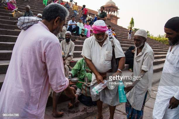 Mohammad Jamil a member of the Bhishti community distributing water to people outside Jama Masjid on May 10 2018 in Old Delhi India The Bhishtis or...