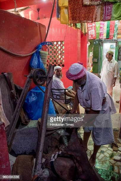 Mohammad Jamil a member of the Bhishti community taking the water out from the old well in the courtyard outside Jama Masjid during the shoot of...