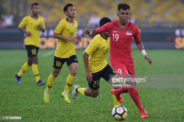 Mohammad Khairul of Singapore controls the ball during the Airmarine Cup match between Malaysia and Singapore at Bukit Jalil National Stadium on...