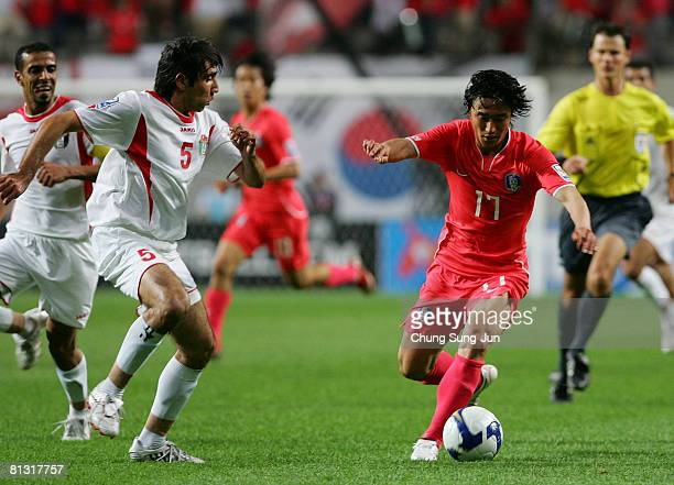 Mohammad Khamees Rajeh Khamees of Jordan and JungHwan Ahn of South Korea in action during the FIFA 2010 World Cup qualifiying match between South...