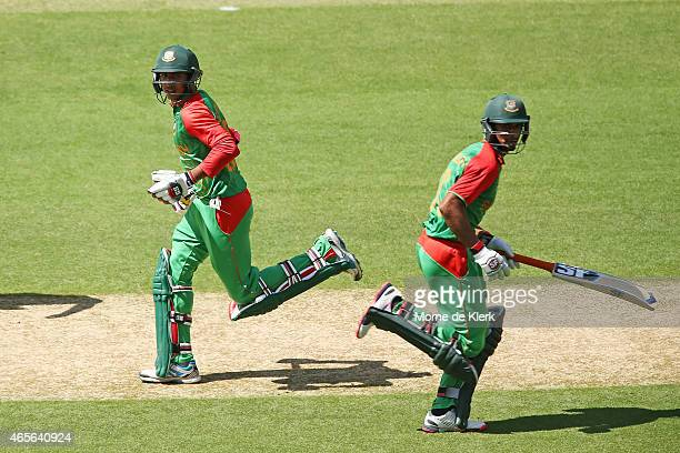 Mohammad Mahmudullah and Soumya Sarkar of Bangladesh run between the wickets during the 2015 ICC Cricket World Cup match between England and...
