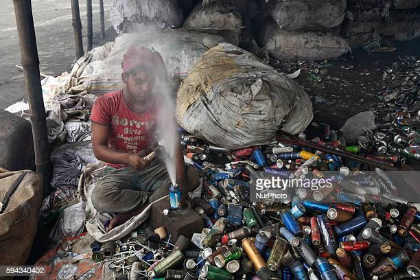 Mohammad Mosharrof sorts aluminium pieces from industrial waste in Dhaka Bangladesh on 22 August 2016 People from the southern part of Bangladesh are...