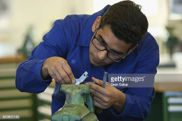 Mohammad Mubasshir Tariq from Pakistan participates in a technical jobtraining program for refugees at a Siemens training center on April 21 2016 in...