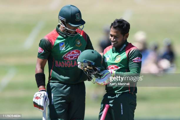 Mohammad Mushfiqur Rahim of Bangladesh checks his helmet after being hit by a bouncer during Game 1 of the One Day International series between New...