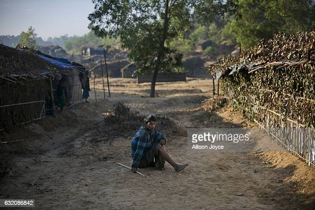 Mohammad Muslim who recently fled violence from Morichabil village in Myanmar poses for a photo in the Balu Kali Rohingya refugee camp on January 19...