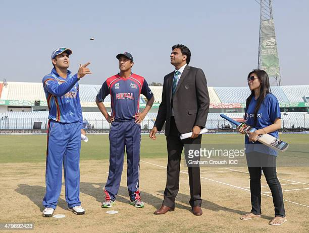 Mohammad Nabi captain of Afghanistan and Paras Khadka captain of Nepal at the coin toss with match referee Javagal Srinath and pepsi mascot Faria...