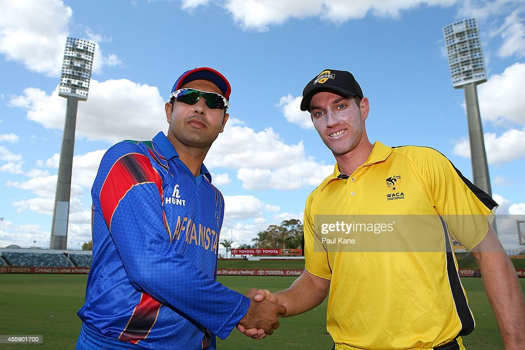 Mohammad Nabi of Afghanistan and Will Bosisto of the WA XI shake hands after the coin toss during the One Day tour match between the Western Australia XI and Afghanistan at the WACA on September 22, 2014 in Perth, Australia.