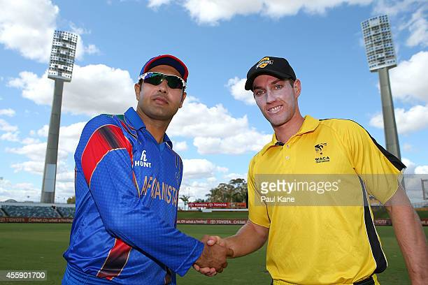 Mohammad Nabi of Afghanistan and Will Bosisto of the WA XI shake hands after the coin toss during the One Day tour match between the Western...