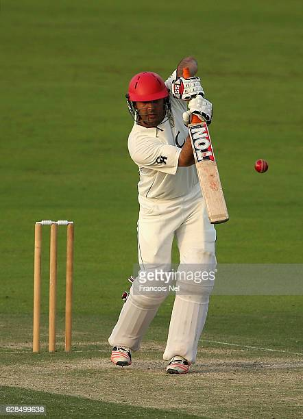Mohammad Nabi of Afghanistan bats during day two of the tour match between England Lions and Afghanistan at Zayed Cricket Stadium on December 8 2016...