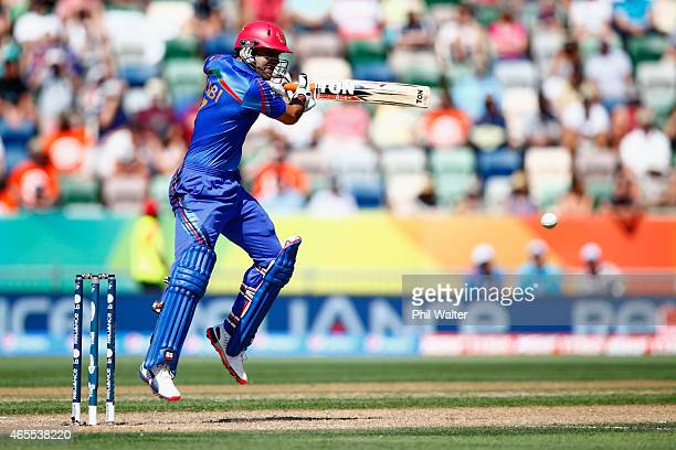 Mohammad Nabi of Afghanistan bats during the 2015 ICC Cricket World Cup match between New Zealand and Afghanistan at McLean Park on March 8 2015 in...
