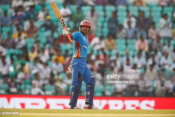 Mohammad Nabi of Afghanistan celebrates his 50 runs during the ICC Twenty20 World Cup Round 1 Group B match between Zimbabwe and Afghanistan at the...