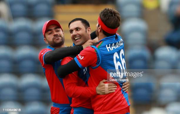 Mohammad Nabi of Afghanistan celebrates with team mates after taking the wicket of Kusal Mendis during the Group Stage match of the ICC Cricket World...
