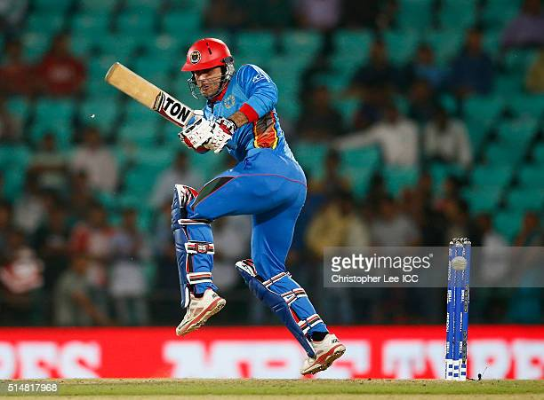 Mohammad Nabi of Afghanistan in action during the ICC Twenty20 World Cup Round 1 Group B match between Hong Kong and Afghanistan at the Vidarbha...