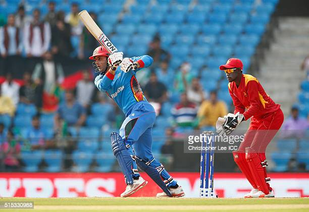 Mohammad Nabi of Afghanistan in action with Richmond Mutumbami of Zimbabwe during the ICC Twenty20 World Cup Round 1 Group B match between Zimbabwe...