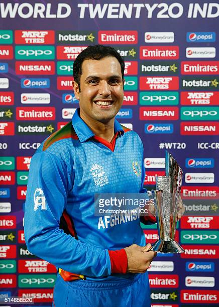 Mohammad Nabi of Afghanistan poses for the camera with his Player of the Match award during the ICC Twenty20 World Cup Round 1 Group B match between...