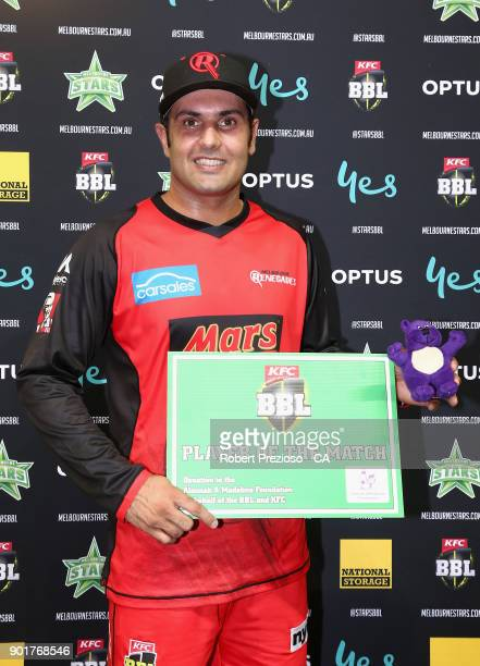 Mohammad Nabi of the Melbourne Renegades is awarded player of the match during the Big Bash League match between the Melbourne Stars and the...