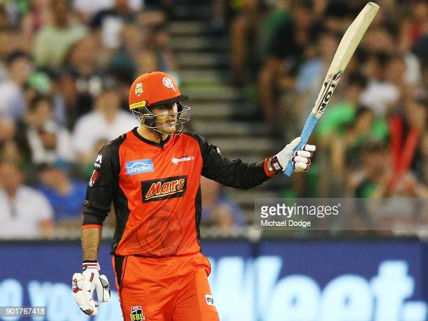 Mohammad Nabi of the Renegades celebrates making his half century during the Big Bash League match between the Melbourne Stars and the Melbourne...