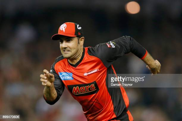 Mohammad Nabi of the Renegades chases the ball into the outfield during the Big Bash League match between the Melbourne Renegades and the Perth...