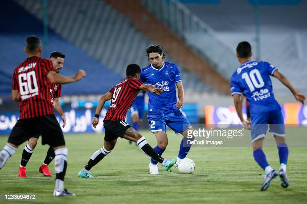 Mohammad Naderi of Esteghlal battle for the ball during the Persian Gulf Pro League match between Esteghlal and Padideh FC at Azadi Stadium on June...