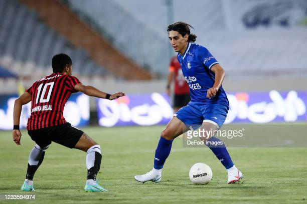 Mohammad Naderi of Esteghlal controls the ball during the Persian Gulf Pro League match between Esteghlal and Padideh FC at Azadi Stadium on June 21,...