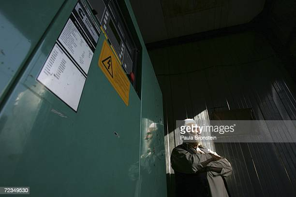 Mohammad Naim guards a large diesel generator that provides 800 killowat of electricity for 600700 families November 1 2006 in Kabul Afghanistan...