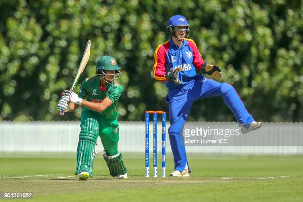 Mohammad Naim of Bangladesh bats as wicketkeeper Lohan Louwrens of Namibia looks on during the ICC U19 Cricket World Cup match between Bangladesh and...
