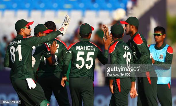 Mohammad Naim of Bangladesh is congratulated after taking a catch to dismiss Charles Amini of Papua New Guinea during the ICC Men's T20 World Cup...
