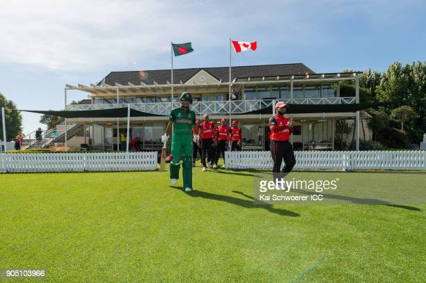 Mohammad Naim Sheikh of Bangladesh and Arslan Khan of Canada walk out prior to the ICC U19 Cricket World Cup match between Bangladesh and Canada at...