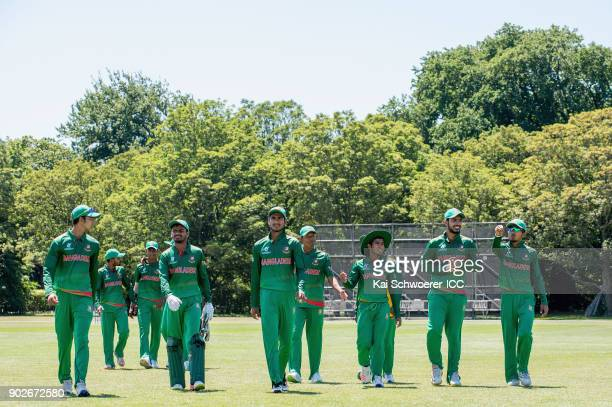 Mohammad Naim Sheikh of Bangladesh and his team mates walk from the ground at the lunch break during the ICC U19 Cricket World Cup Warm Up Match...