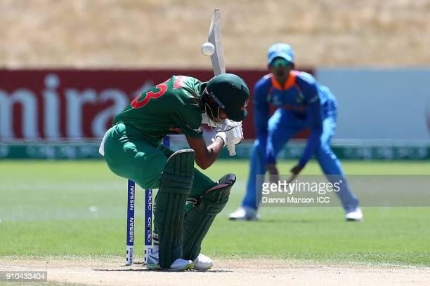 Mohammad Naim Sheikh of Bangladesh avoikds a bouncer during the ICC U19 Cricket World Cup match between India and Bangladesh at John Davies Oval on...