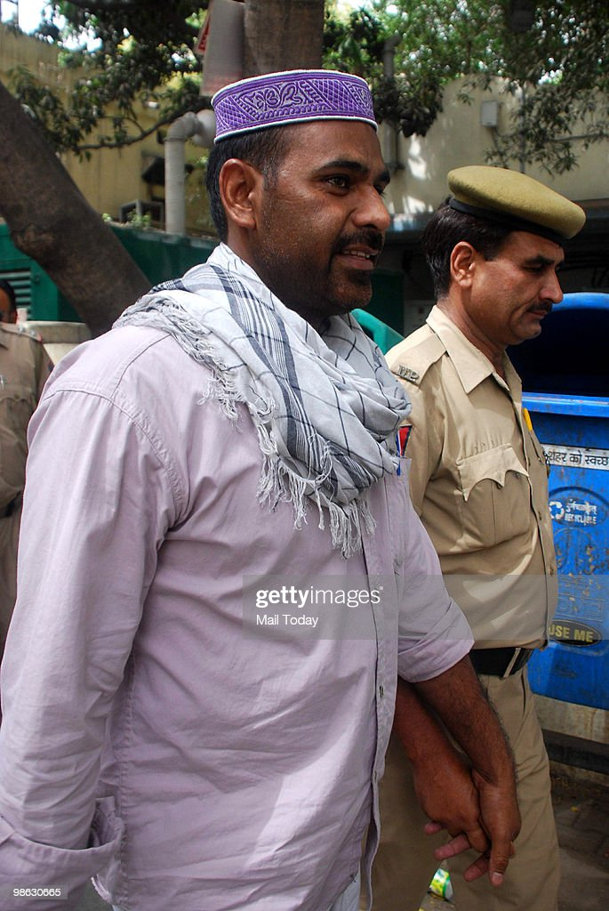 Mohammad Naushad, one of the convicts of the 1996 Lajpat Nagar blast case, is escorted out of a court after pronouncement of the sentence against him in New Delhi on April 22, 2010. The court sentenced him with rigorous life imprisonment.