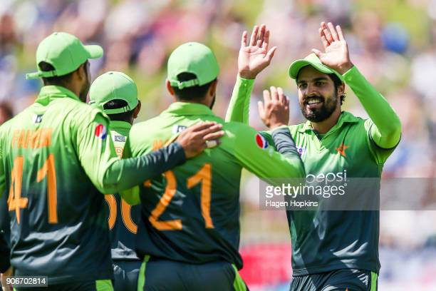 Mohammad Nawaz of Pakistan celebrates with Shoaib Malik after taking the wicket of Colin Munro of New Zealand during game five of the One Day...