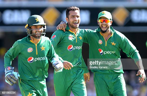 Mohammad Nawaz of Pakistan celebrates with team mates after taking the wicket of James Faulkner of Australia during game one of the One Day...