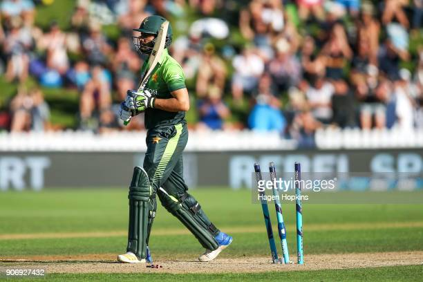 Mohammad Nawaz of Pakistan leaves the field after being dismissed after being bowled out during game five of the One Day International Series between...