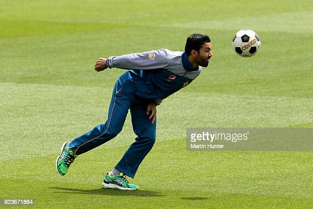 Mohammad Nawaz of Pakistan plays soccer as rain and wind delays play on day one of the First Test between New Zealand and Pakistan at Hagley Oval on...
