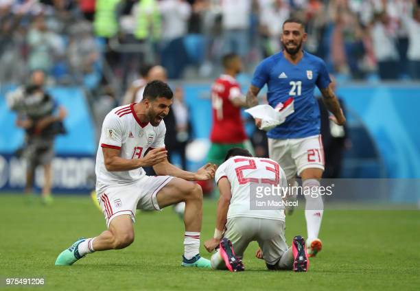Mohammad Reza Khanzadeh and Ramin Rezaeian of Iran celebrate at full time during the 2018 FIFA World Cup Russia group B match between Morocco and...