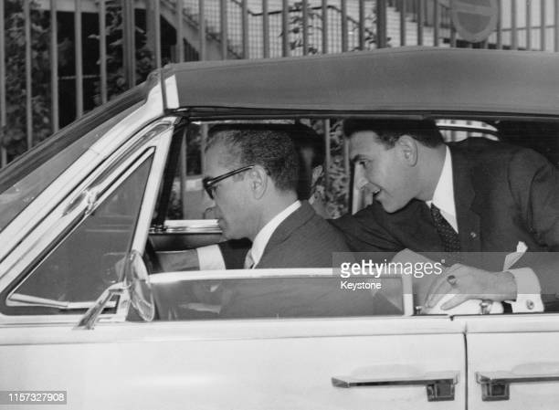 Mohammad Reza Pahlavi , Shah of Iran, driving a Lincoln Continental convertible during a visit to Rome, 25th May 1961. With him is his son-in-law,...