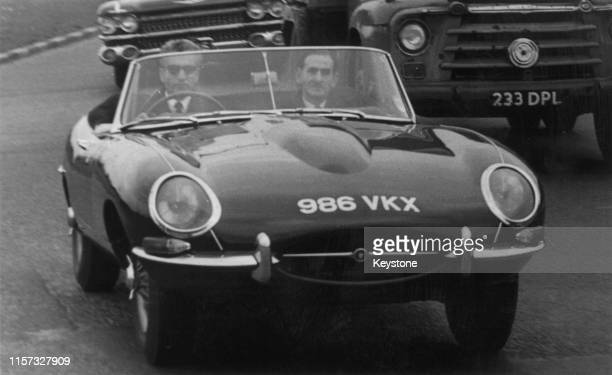 Mohammad Reza Pahlavi , Shah of Iran, test-driving a Jaguar E-Type sports car on the Chertsey Road, near Richmond, Surrey, 1st May 1962. Two embassy...