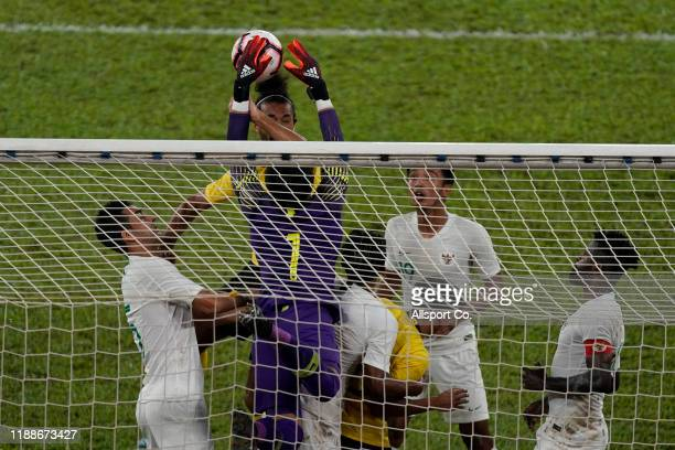 Mohammad Ridho goalkeeper of Indonesia is checked by Corbin Ong of Malaysia during the 2022 Qatar FIFA World Cup Asian qualifier group G match...