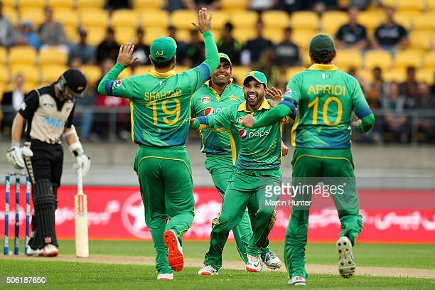 Mohammad Rizwan of Pakistan celebrates with team mates after running out Colin Munro of New Zealand during the Twenty20 International match between...