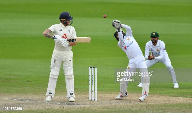 Mohammad Rizwan of Pakistan parries the ball prior to taking the catch on the second attempt to dismiss Ben Stokes of England during Day Four of the...