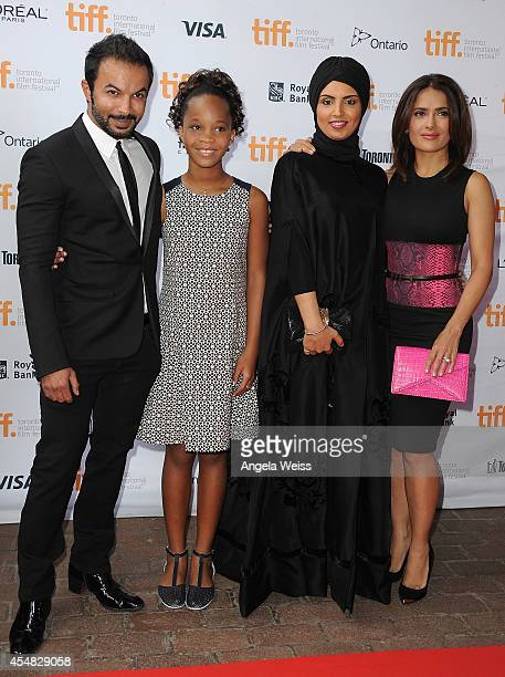 Mohammad Saeed actress Quvenzhane Wallis Fatma Al Remaihi and actress Salma Hayek attend the 'Kahlil Gibran's The Prophet' premiere during the 2014...