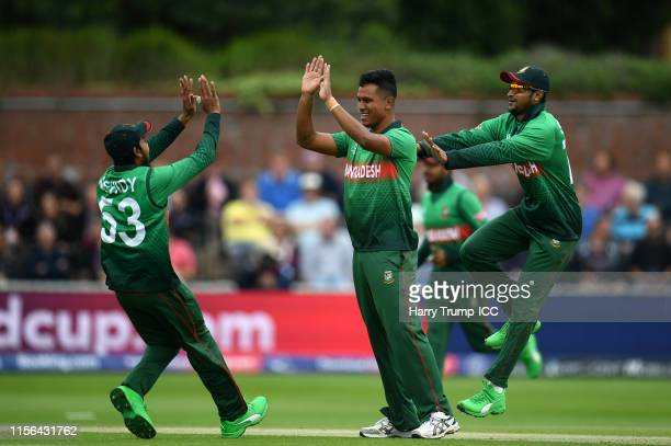 Mohammad Saifuddin of Bangladesh celebrates after taking the wicket of Chris Gayle of West Indies during the Group Stage match of the ICC Cricket...
