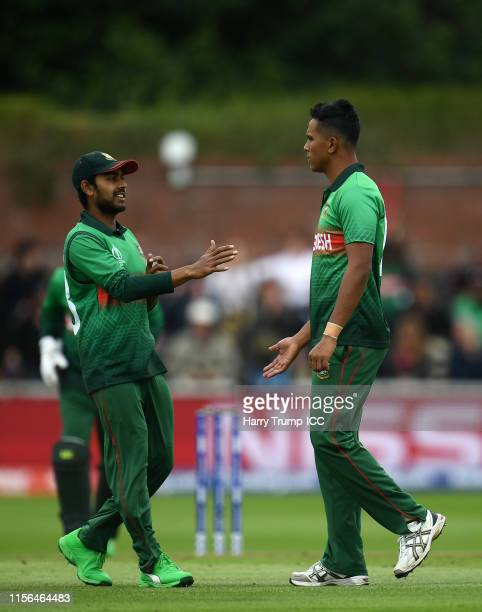 Mohammad Saifuddin of Bangladesh celebrates after taking the wicket of Jason Holder of West Indies during the Group Stage match of the ICC Cricket...